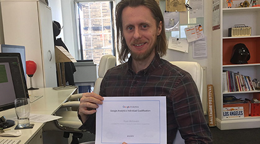Image of someone holding a Google Analytics Certificate
