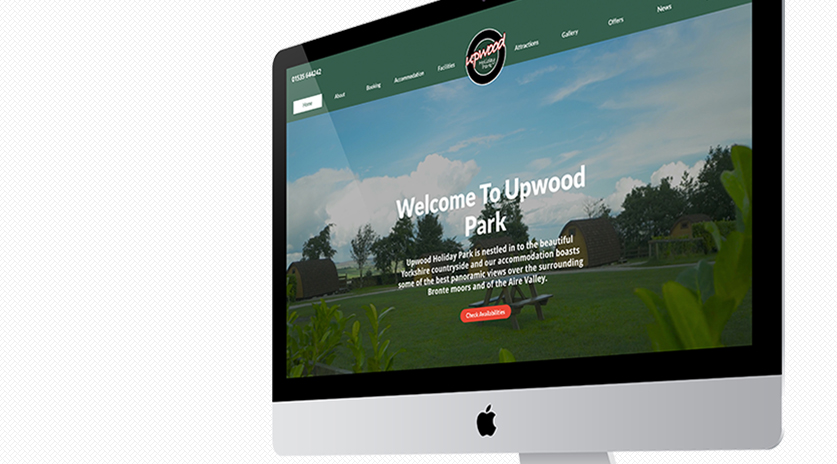 Mockup of a Mac showing Upwood Holiday Park website design